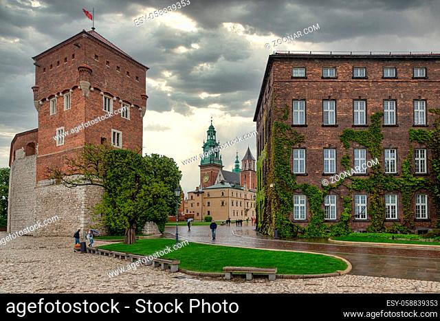 View at Wavel square with medieval buildings during a rainy day in Krakow, Poland