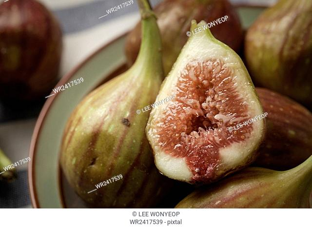 Close up of figs including the cross section of one