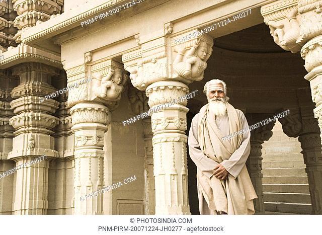 Sadhu standing in a temple, Scindia Ghat, Ganges River, Varanasi, Uttar Pradesh, India