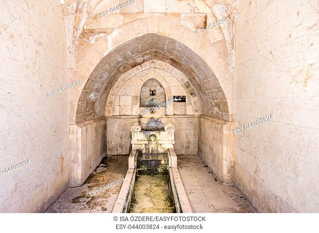View of fountain for ablution in courtyard of Abdullatif Mosque which was built during Artuklu period in Mardin, Turkey. 17 June 2018
