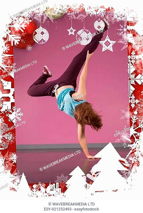 Pretty break dancer doing handstand with one hand