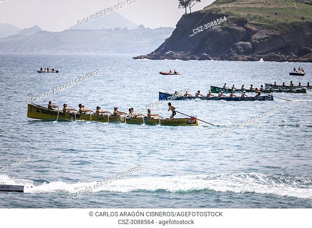 CASTRO URDIALES, SPAIN - JULY 15, 2018: Competition of boats, regata of trainera, Orio Babyauto, Urdaibai Avia, Go Fit Hondarribia and Zierbena Bahias Bizkaia...