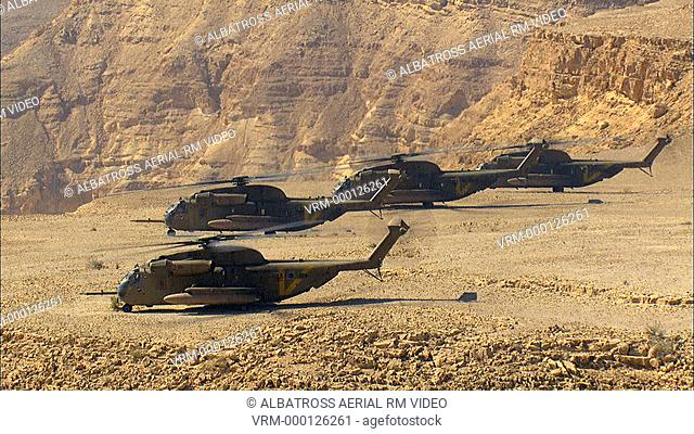Aerial footage of four Military Helicopters in the Negev Desert