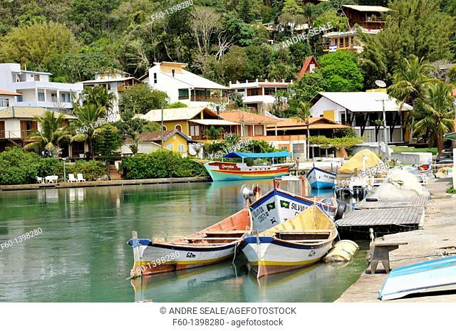 Boats and houses on canal, Fishing village, Barra da Lagoa, Florianopolis, Santa Catarina, Brazil, South Atlantic
