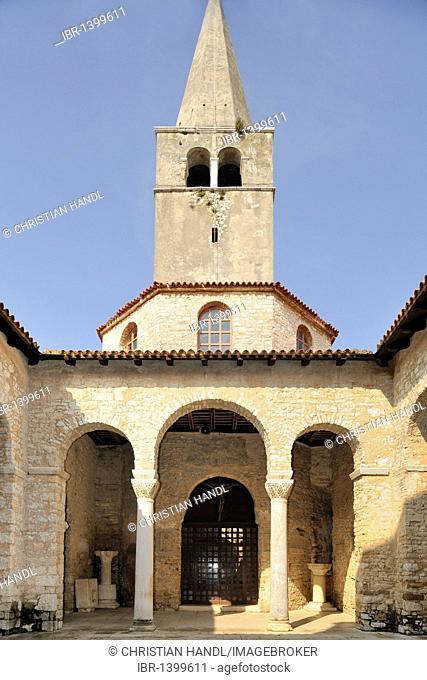 Courtyard with a tower of the Euphrasian Basilica in Porec, Croatia, Europe