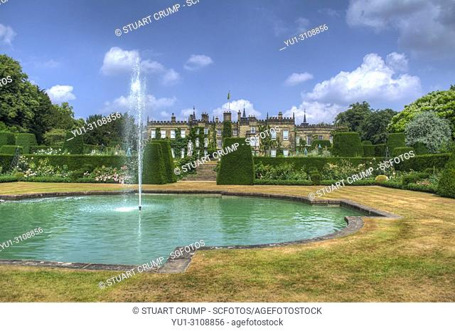 HDR image of the Hall and swimming pool fountain at Renishaw Hall and Gardens, Renishaw, Derbyshire, UK