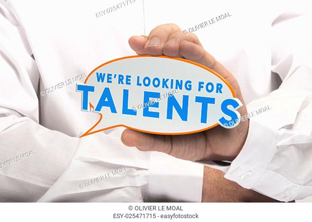 Man holding a comics bubble with the text we are looking for talents. Concept image for illustration of talent recruitment or job opportunities