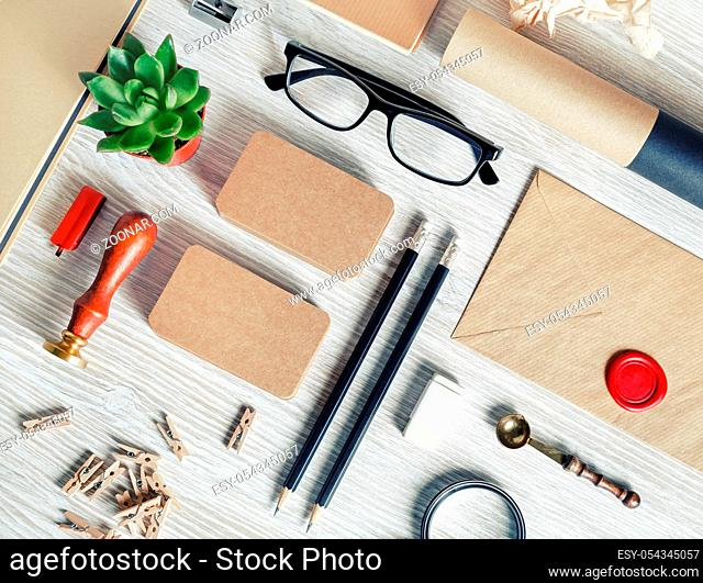 Vintage blank stationery set on light wood table background. Corporate ID template. Flat lay