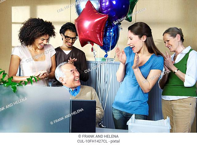 Group of office workers celebrating