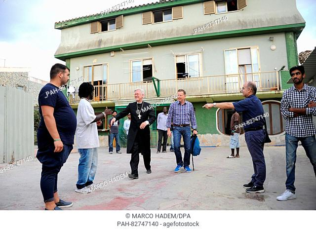 Heinrich Bedford-Strohm, chairman of the Evangelical Church in Germany (EKD, 2nd l) visits a refugee shelter of Caritas on the island of Sardinia, Italy