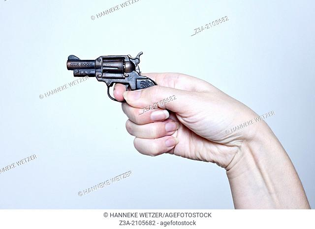 Hand Shooting Little Pistol, Hand Gesture, Studio shot