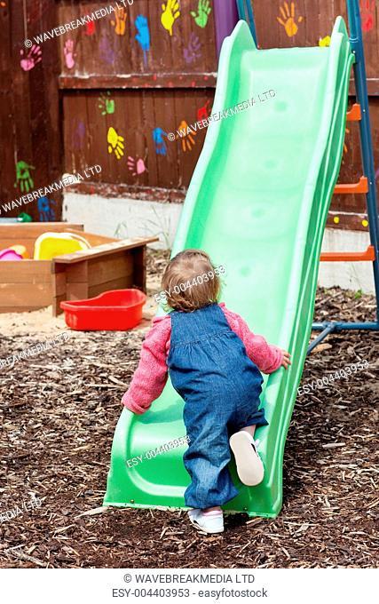 Little girl having fun with a chute