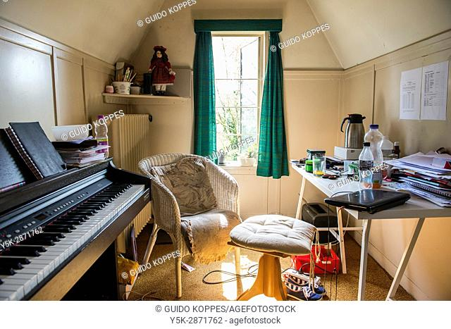 Tilburg, Netherlands. Attic room interior of a classical singing and music teacher's rehearsal room