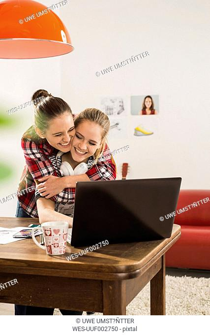 Two female friends having fun together at home