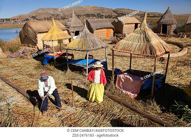 Aymara people welcoming a boat, Uros Islands, Lake Titicaca, Puno, Peru, South America