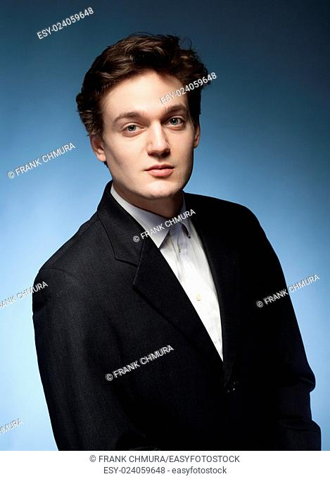 Portrait of a Young Man with Brown Hair in Suit