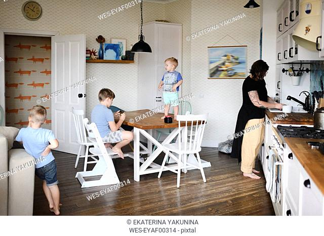 Mother with her three sons in the kitchen