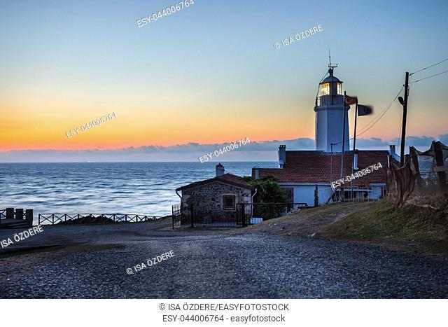 Sunset view of old white Inceburun lighthouse on the north coast of Sinop, Turkey
