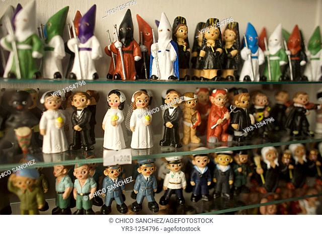 Ceramic dolls in the likeness of Easter penitents sit in a shop window before Holy Week in Seville in Spain's Andalucia region  Easter processions in Andalucia...