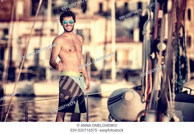 Happy man on the sailboat
