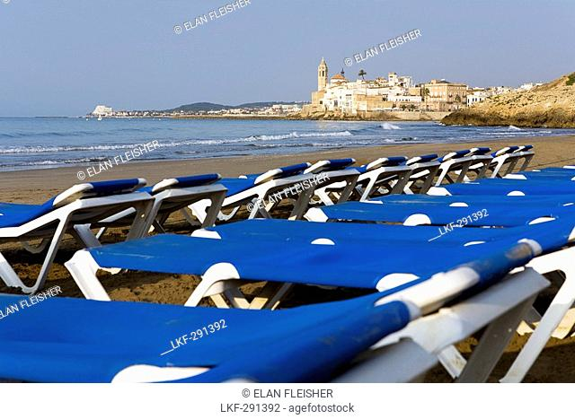 Sunloungers on the deserted beach, Sitges, Catalonia, Spain, Europe