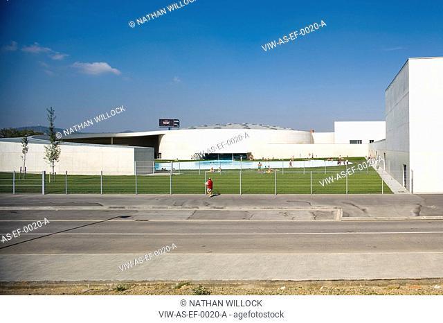 PARC ESPORTIU LLOBREGAT, AV. BAIX LLOBREGAT, S/N, BARCELONA, SPAIN, ALVARO SIZA, EXTERIOR, HIGH VIEW OF THE OUTSIDE POOL WITH PEOPLE AND WALKER