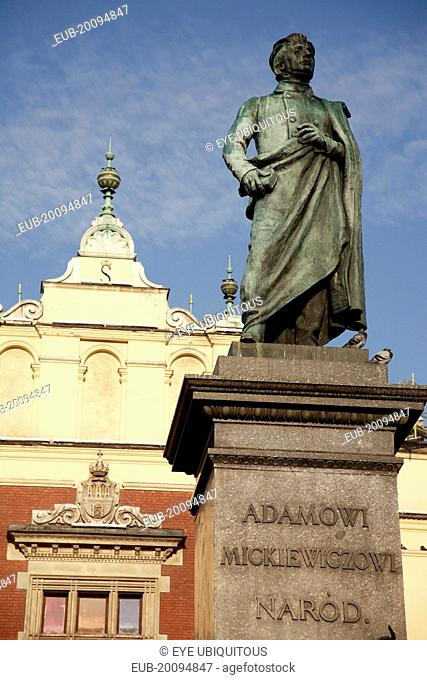 Stare Miasto Rynel Glowny. Memorial statue of the Romantic poet Adam Mickiewicz by Teodor Rygier 1898. Standing figure of Mickiewicz on pedestal top with the...