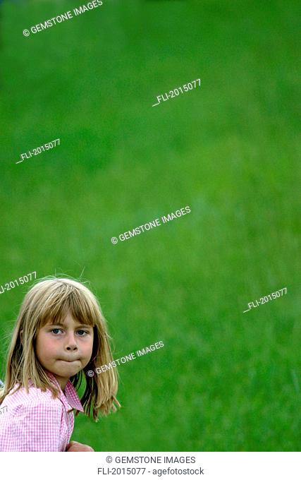Girl With Green Grass Background
