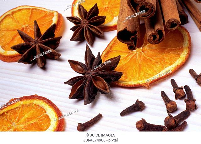 Tilted view of dried orange slices and cloves