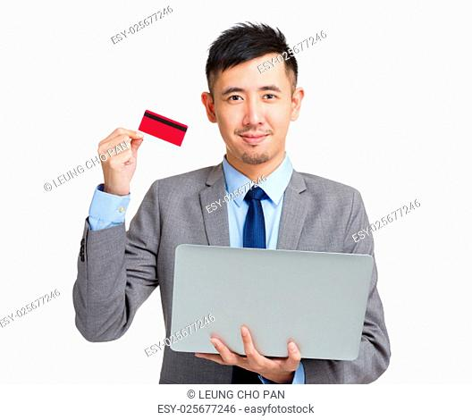 Asian Businessman hold with notebook computer and credit card