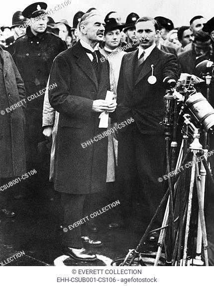 Neville Chamberlain, Prime Minister of Great Britain reporting there will be 'Peace in our time'. Returning from the Munich Conference, he holds the document