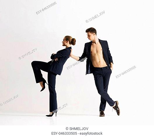 Couple of sporty ballet dancers performing in a studio