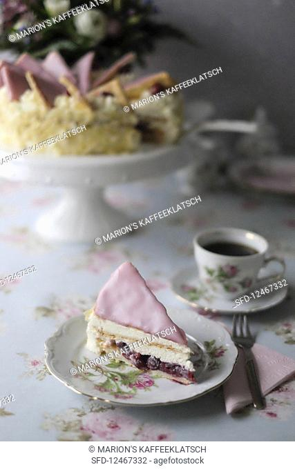 A slice of Dutch cherry cake with puff pastry
