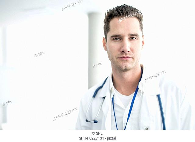 Mature male doctor looking at camera