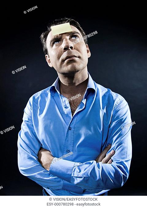 caucasian man looking up pensive portrait isolated studio on black background
