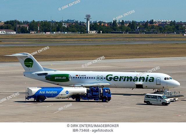 Air Germania airplane and ARAL kerasin tank truck at Tegel airport, Berlin, Germany, Europe