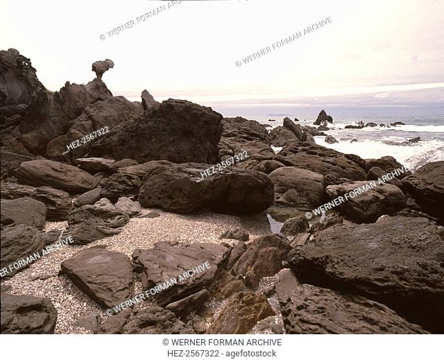 Rocks on the beach below Mount Maunganui, at the entrance to Tauranga harbour. Country of Origin: New Zealand. Place of Origin: North Island