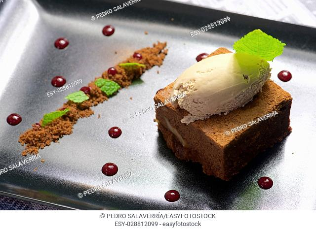 Chocolate brownie with ice cream and mint