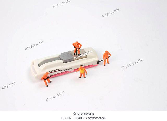 Miniature people in engineer or worker occupation isolate