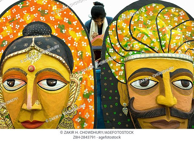 DHAKA, BANGLADESH - APRIL 12 : Students of the Institute of Fine Arts in Dhaka University busy to making the colorful masks