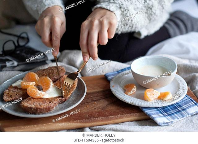 Breakfast in bed: French toast with cinnamon and citrus yoghurt