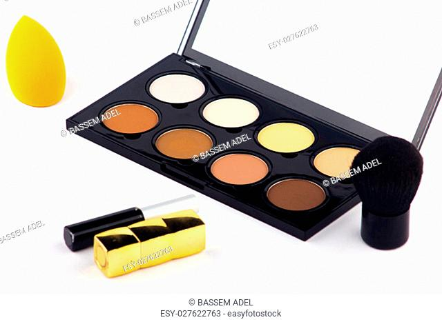 Makeup and Cosmetics. Makeup Palette and tools on a white background