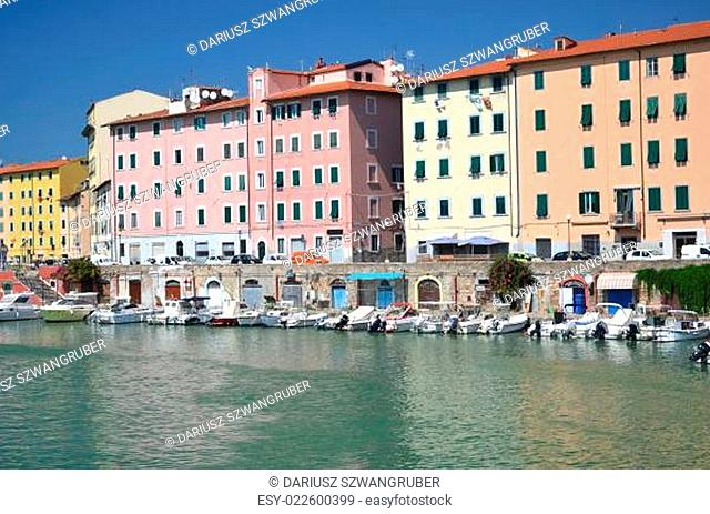Picturesque view on boats in city channel in Livorno, Italy