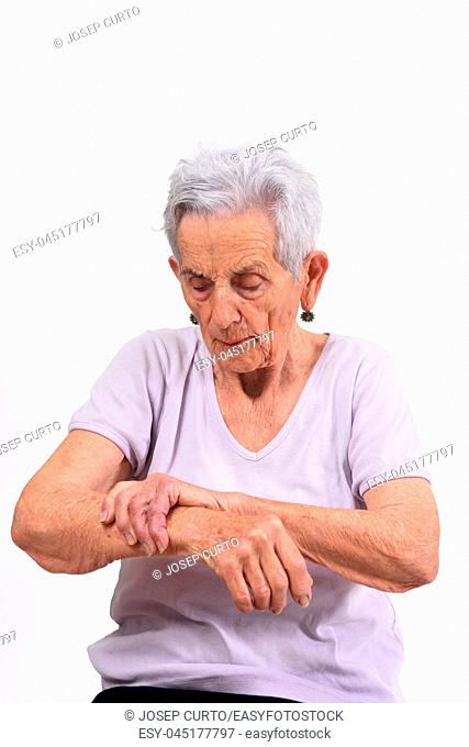 senior woman with pain on wrist on white background