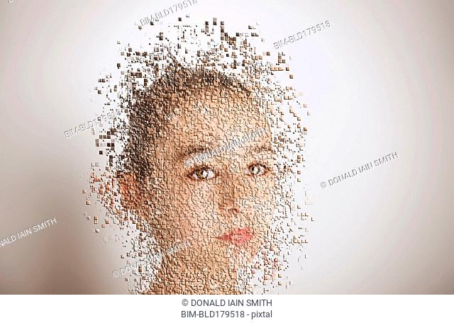 Pixelated mixed race girl with serious expression