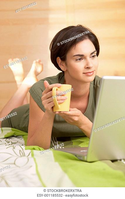 Mid-adult woman having morning coffee