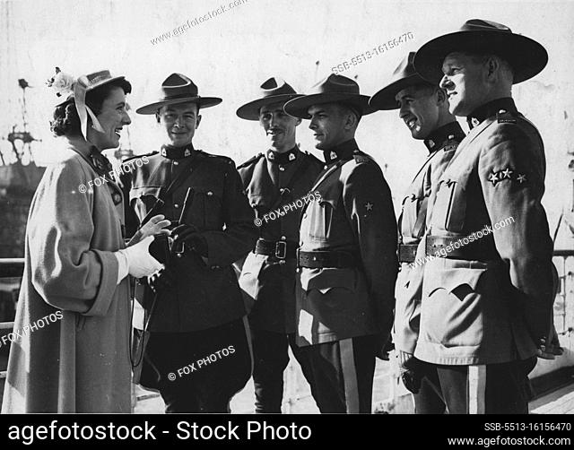 """""""""""""""Mopnties"""""""" Arrive For Coronation. Sheila Oxley, a Coronation visitor from Toronto (Canada) starts off her """"""""Coronation Album"""""""" by snapping the Mounties on..."""