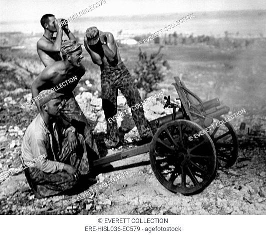 Marines fire a captured Japanese mountain gun in Garapan, Saipan, July 1944. (BSLOC-2013-12-212)