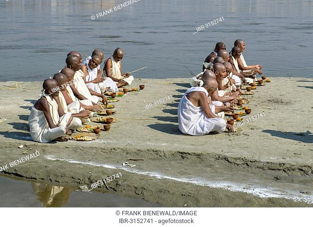 Group of new Jain nuns sitting at the banks of the river Ganges during their initiation, during Kumbha Mela festival