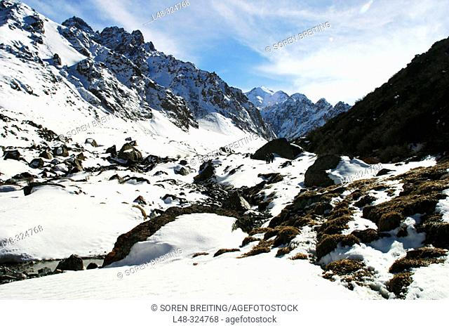Kyrgyzstan, Central Asia: Mountains and valley with melting snow near the capital Bishkek during early spring in april